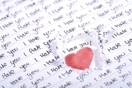 Valentine Photo Concept: Love beneath the I hate you words Stock Photo - 11598120