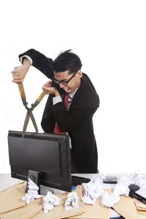 glass cutter: Angry businessman about to cut his monitor in two isolated om white Stock Photo
