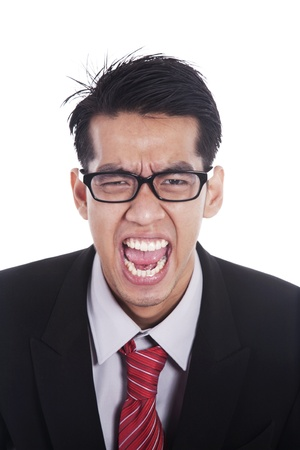 Angry Asian businessman screaming isolated on white photo