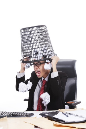 Mad Asian businessman with trash bin on his head isolated on white photo