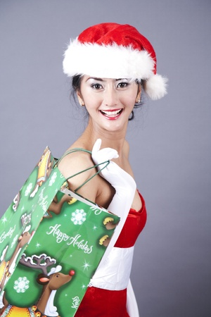 Pretty Asian woman with shopping bag photo