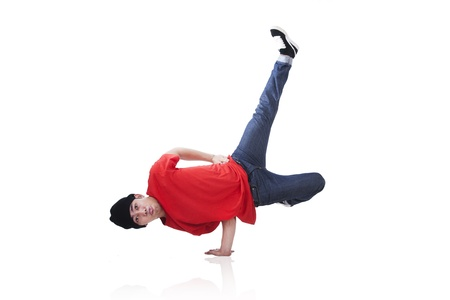 Asian man showing off some breakdance moves isolated on white photo