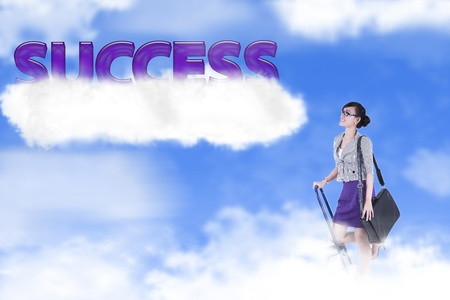 Success photo concept: businesswoman climbing ladder to the sky photo