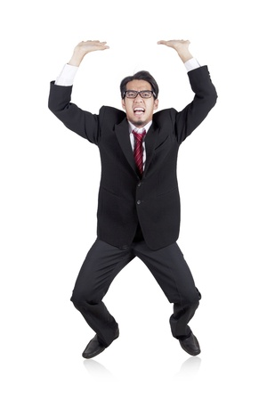 Asian businessman carrying something heavy above his head Stock Photo - 12150114