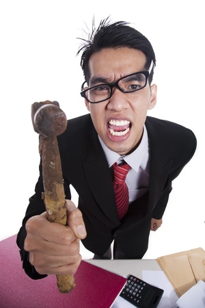 Angry Asian businessman with hammer isolated on white Stock Photo - 12150121