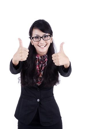 Isolated beautiful businesswoman showing two thumbs up on white background photo
