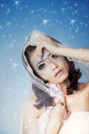 Beautiful woman on blue stars background Stock Photo - 14690520