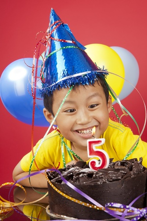Happy asian boy celebrating birthday photo