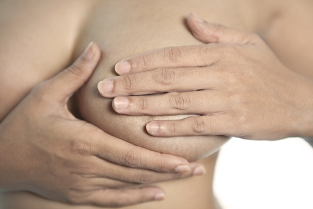 breast examination: Woman pressing her breast to check the breast cancer