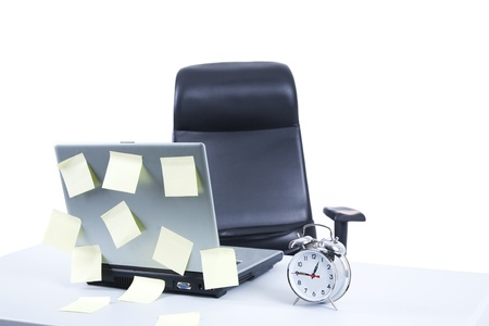 empty chair: Business desk with laptop, watch, and notepad Stock Photo