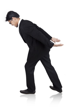 Asian businessman carrying heavy load on his back photo