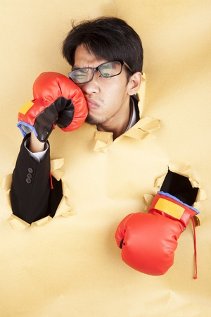 Asian businessman hit his face with boxing glove photo