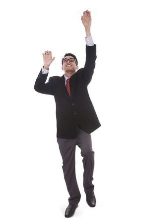 top: Isolated businessman trying to climb upward on white background
