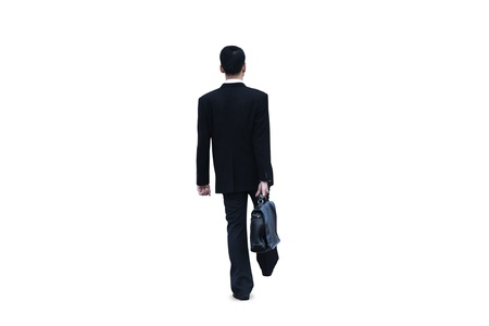 Isolated businessman walking on white background photo