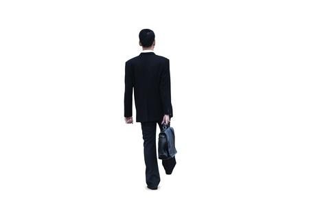 Isolated businessman walking on white background photo