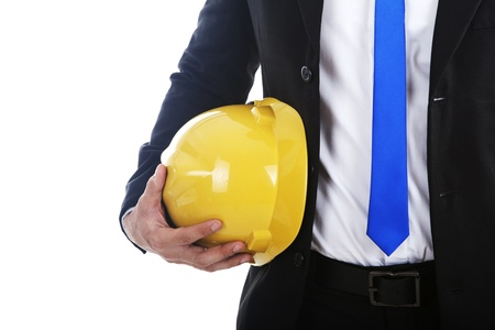 A businessman holding an engineer helmet isolated on white Stock Photo