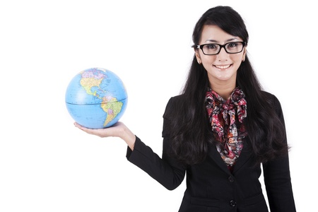global investing: Isolated asian businesswoman holding a globe on white background