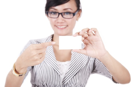 businesscard: Beautiful businesswoman pointing on blank businesscard Stock Photo
