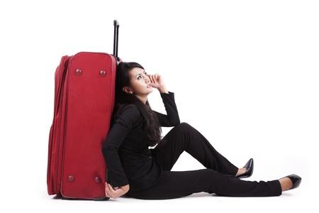 lugage: Isolated businesswoman sitting on white background with lugage
