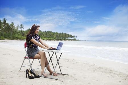 Asian businesswoman working at beach Stock Photo - 12150160