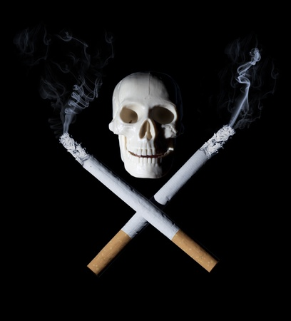 lifestyle disease: Two cigarettes with skull - danger of smoking concept Stock Photo