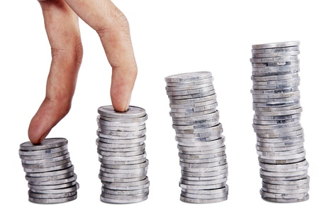 Two finger climbing stack of coins Stock Photo - 12150103