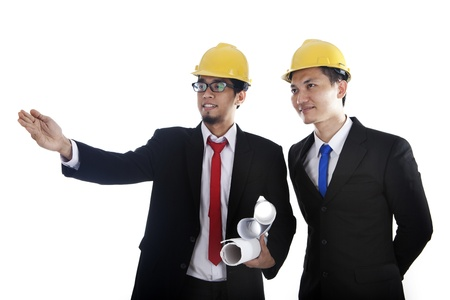 Engineer showing something to his colleague during meeting  photo