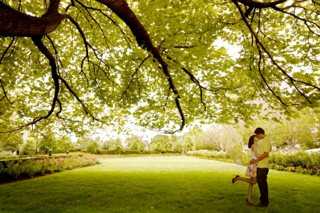 romantic kiss: Asian young couple kissing under tree Stock Photo