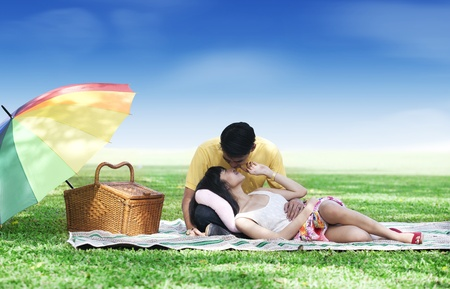 Romantic young couple picnic together in the park photo
