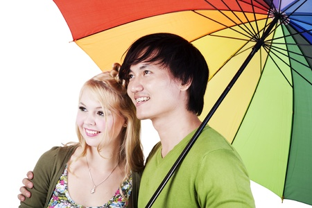 chinesse: Mixed race couple holding an umbrella isolated on white  Stock Photo