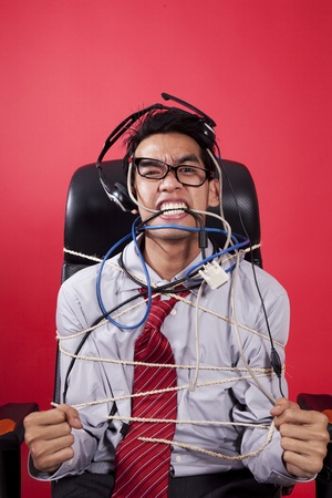 Mad customer service staff tied up on chair Stock Photo - 12150148