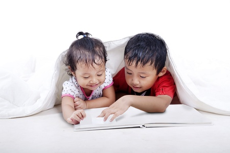 Asian kids reading an empty book isolated on white photo