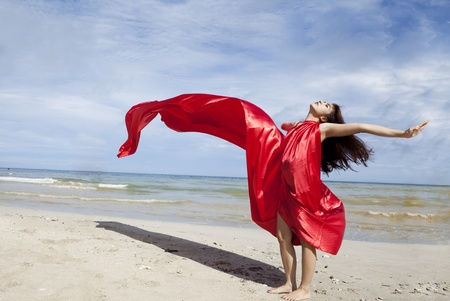 beach wrap: Beautiful asian woman in a red scarf on the beach Stock Photo