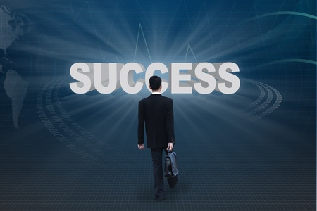 Businessman walking with briefcase go to success photo