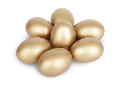 accrue: Isolated gold eggs on white background