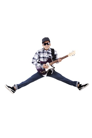 Guy plays guitar while jumping on white background photo