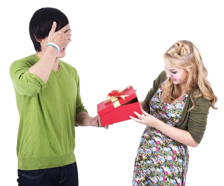 Couple with a surprised present isolated on white photo
