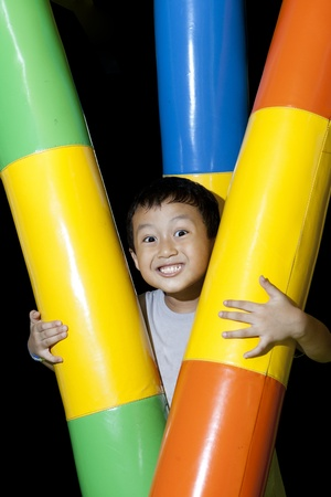 Happy small boy with playground equipment photo