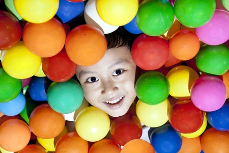 Happy small face in colorful ball photo