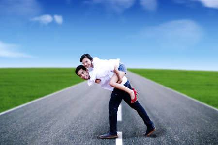 Happy young couple enjoying their summer holiday together. Stock Photo - 12150280