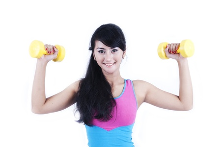 dumbell: Beautiful woman working outwith dumbell  isolated on white Stock Photo
