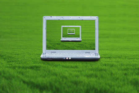 A wireless laptop on the green grass photo