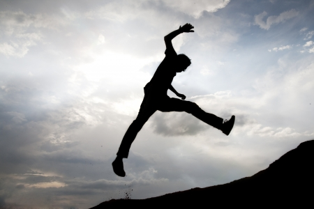 high jump: Silhouette of jumping man  Stock Photo