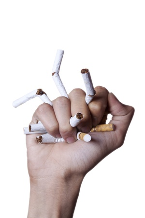 Quit smoking concept hand crushing the cigarettes on white backgroung photo