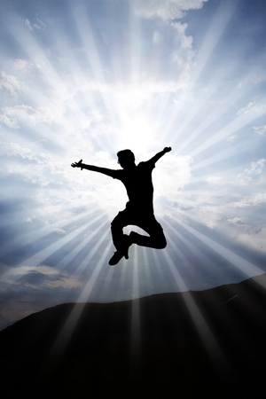 Silhouette happy man jumping on the sky photo