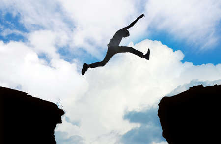 gaps: Siluet of jumping man  Stock Photo