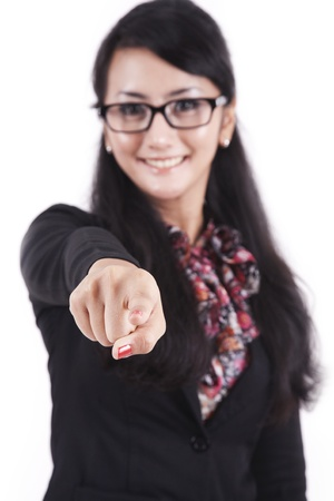 directing: Smiling success businesswoman pointing with her finger