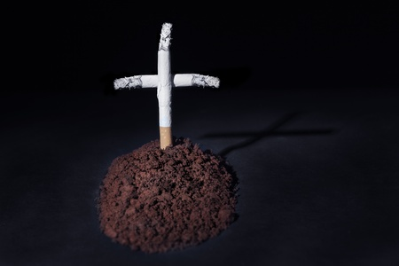 sod: A cemetery with a grave made of cigarettes Stock Photo
