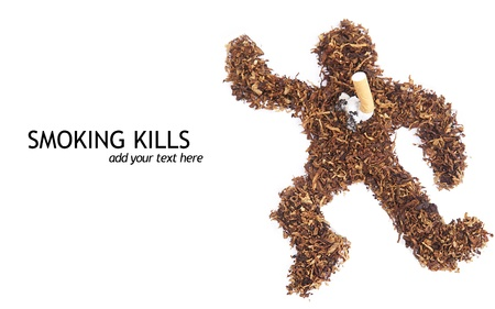 Isolated smoking kills concept dead body made of tobacco photo