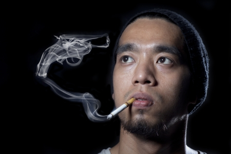 cigarette filter: Man smoking with a pistol made of smoke